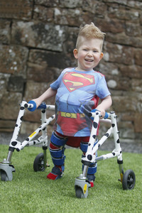 Models Direct's Noah in his superman costume